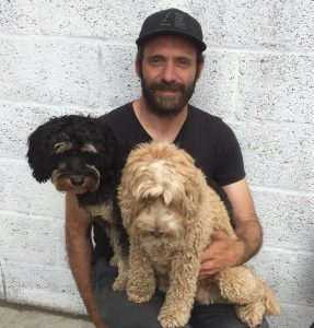 David holding Dogs